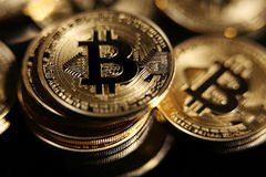 Bitcoin. Golden Bitcoin digital currency, financial industry, Black background Stock Photos