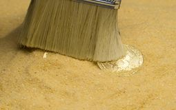 Bitcoin on golden sand. An archaeologist with a brush clears the bitcoin coin on the golden sand stock photo