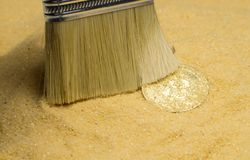 Bitcoin on golden sand. An archaeologist with a brush clears the bitcoin coin on the golden sand royalty free stock photo