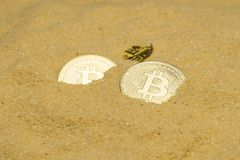 Bitcoin on golden sand. Several bitcoin crypto coins on brilliant golden sand. finding and mining cryptocurrency stock photography