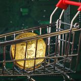 Bitcoin in the grocery cart royalty free stock image