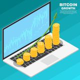 Stack of golden Bitcoin to open the laptop with growth graph. Bitcoin growth concept. Stack of golden Bitcoin to open the laptop with growth graph. The concept Royalty Free Stock Images