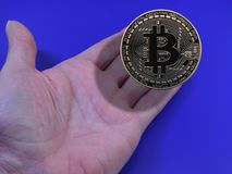 Bitcoin in hand. Bitcoin floating above open hand Stock Photography