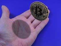 Bitcoin in hand. Bitcoin floating above open hand Royalty Free Stock Photography
