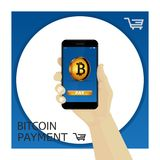 Bitcoin. Hand holding smartphone with golden bitcoin and button. Bitcoin contactless payment. Hand holding smartphone with golden bitcoin and button `pay` Royalty Free Stock Photography