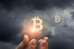 Bitcoin in the hand . Bitcoin in the hand on sky background Stock Image