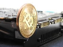 Bitcoin hanging on graphics processing unit or GPU Royalty Free Stock Photography