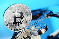 Bitcoin on the HDD disk Royalty Free Stock Images