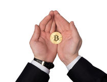 Bitcoin holds. In the palms Royalty Free Stock Photos