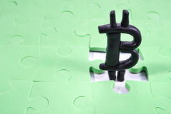 Bitcoin in the hole puzzle Royalty Free Stock Photography