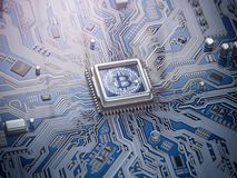 Bitcoin hologram over CPU core and computer circuit board or mot Stock Image