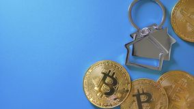 Bitcoin and house model in form of keychain stock images