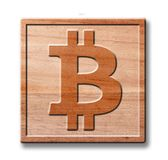 Bit coin wooden icon royalty free stock images