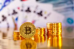 BItcoin infront of US dollars Royalty Free Stock Photography