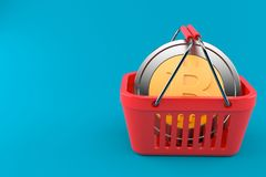 Bitcoin inside shopping basket. Isolated on blue background. 3d illustration Royalty Free Stock Photos