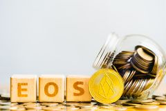 EOS Coins and Wood block word EOS.