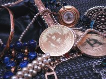 Bitcoin and jewels found in a purse royalty free stock photo