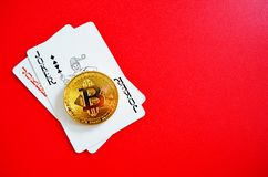 Bitcoin with joker playing cards stock photo