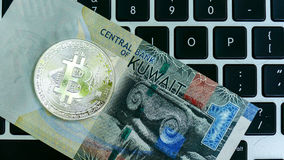 Bitcoin on Kuwait dinar banknote Stock Photos
