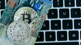 Bitcoin on Kuwait dinar banknote Stock Photography