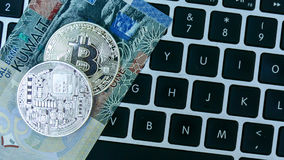 Bitcoin on Kuwait dinar banknote Royalty Free Stock Photos
