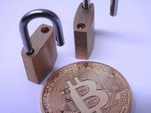 Bitcoin and brass padlocks Royalty Free Stock Photos