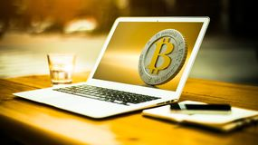 Bitcoin and laptop Stock Images