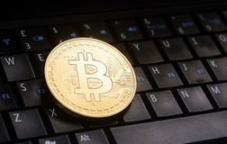 Bitcoin  on laptop. Golden bitcoin  coin  on laptop  keyboard Royalty Free Stock Photography