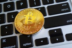Bitcoin on the Laptop Keyboard Background stock photos