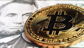 Bitcoin on lincoln portrait Stock Images
