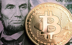 Bitcoin on lincoln portrait Royalty Free Stock Image