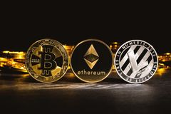 Bitcoin, Litecoin and Ethereum coins. On a dark background Royalty Free Stock Images