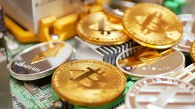 Bitcoin, Litecoin and Ethereum Coins on PC Motherboard