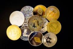 Bitcoin, litecoin, etherium coins close up. Dark theme stock photography