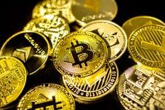 Bitcoin, litecoin, etherium coins close up. Dark theme royalty free stock image