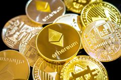 Bitcoin, litecoin, etherium coins close up. Dark theme stock image