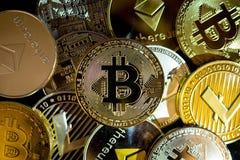 Bitcoin, litecoin, etherium coins close up. Dark theme royalty free stock photos
