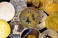 Bitcoin, litecoin, etherium coins close up. Dark theme stock images