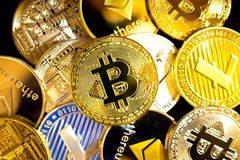 Bitcoin, litecoin, etherium coins close up. Dark theme stock photo