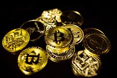 Bitcoin, litecoin, etherium coins close up. Dark theme royalty free stock images