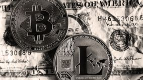 Bitcoin and Litecoin over dollar banknotes. Black and white. Bitcoin and Litecoin over dollar banknotes on black and white tones. Cryptocurrency Trading concept Royalty Free Stock Images