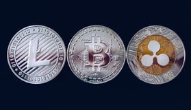 Bitcoin, litecoin and ripple coins currency finance money on graph chart background. Bitcoin as most important cryptocurrency. Concept. Stack of royalty free stock photography