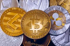 Bitcoin, litecoin and ripple coins currency finance money on graph chart background. Bitcoin as most important cryptocurrency. Concept. Stack of stock images