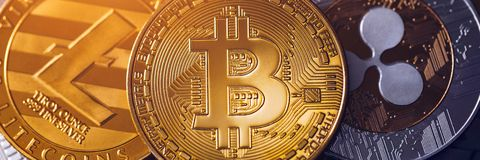 Bitcoin, litecoin and ripple coins currency finance money on graph chart background. Bitcoin as most important cryptocurrency. Concept. Stack of royalty free stock photos