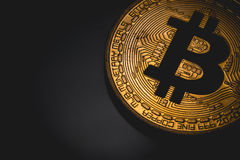 Bitcoin logo. In the dark Royalty Free Stock Photo