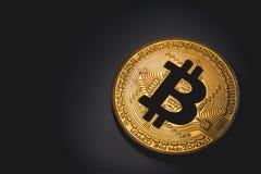 Bitcoin logo. Golden bitcoin logo in the dark Royalty Free Stock Photography