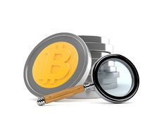 Bitcoin with magnifying glass Royalty Free Stock Images