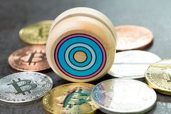 Bitcoin market price yoyo effect, swing up and down, cryptocurrency risk metaphor, wooden yo-yo toy with physical bitcoin coins o stock photo