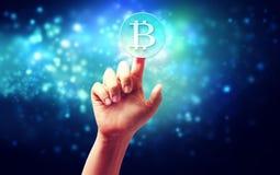 Bitcoin med handen Arkivbilder
