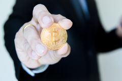 Bitcoin and men's background show. Concept market in the future. royalty free stock photography